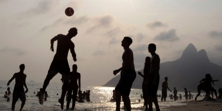 People play soccer at Ipanema