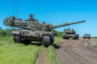 Two Leopard 2 tanks and a Badger Armoured Engineer